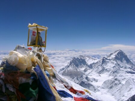 prayer-flags-and-buddha-on-the-summit-of-everest-21-may